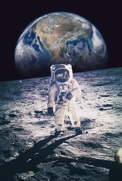 Astronaut walking on moon with earth in background. Elements of