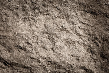 Stone background, rock wall backdrop with rough texture. Abstract, grungy and textured surface of stone material. Nature detail of rocks. Fotobehang
