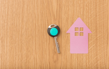 Key and house symbol. Concept image of new property, buying an estate or home security.