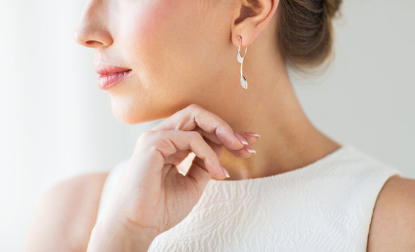 close up of beautiful woman face with gold earring