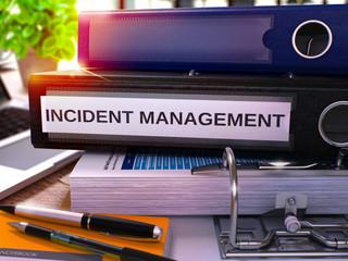 Black Office Folder with Inscription Incident Management. 3D Rendering.