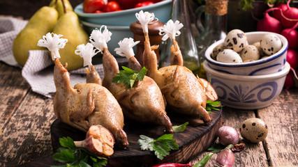 Fresh organic quails on vintage wooden table, healthy food