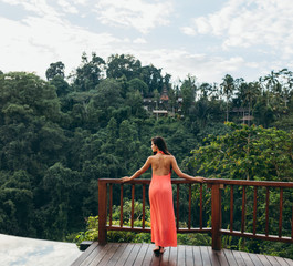 Rear view of woman at luxury holiday resort