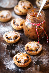 Traditional festive Christmas mince pies with a jar of homemade mincemeat and an empty tag
