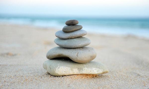 Zen stones on the sand