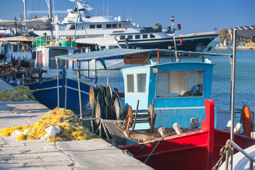 Colorful wooden fishing boats moored in port
