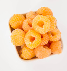 Raspberries: a bowl of fruit on white background