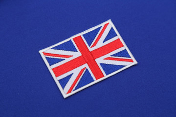 uk flag patch on blue fabric