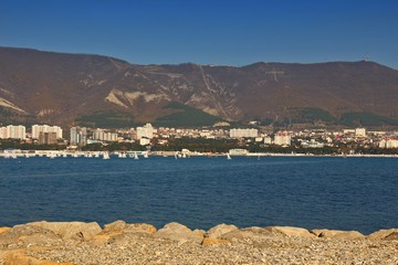 Foto op Canvas Arctica Sea resort town of Gelendzhik in sunny day on Black sea coast. View on city center with mountains in background. Letters on mountain from russian: Gelendzhik
