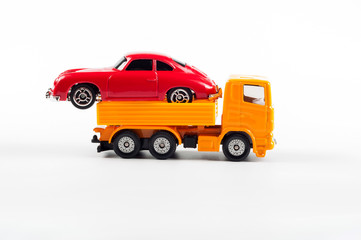 Transporting a new car on a white background