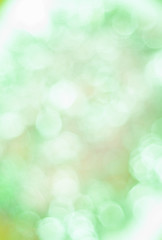 Blurred background with bokeh lights in green pastel colours