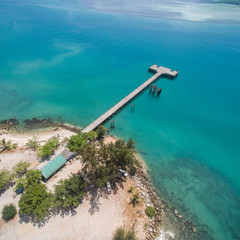 Aerial view of the pier in the bay with turquoise water Koh Phangan Thailand