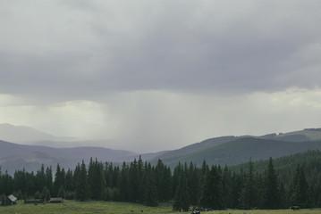 Analog film photo of rain in mountains