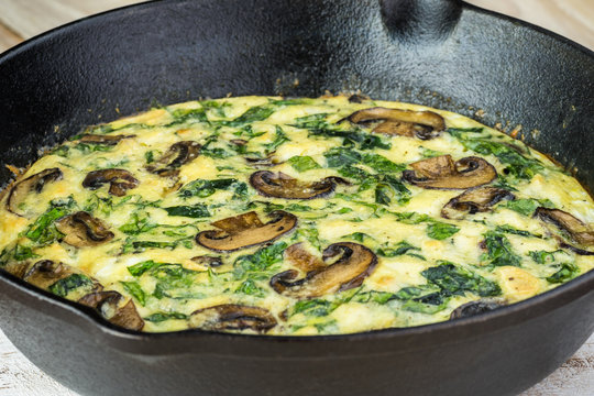 Fresh cooked spinach mushroom frittata.