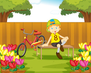 Boy and his bike in the garden