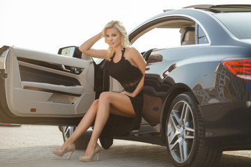 Sexy blonde woman with sport car