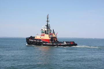 Tugboat; This working tugboat is on it's way out to sea.