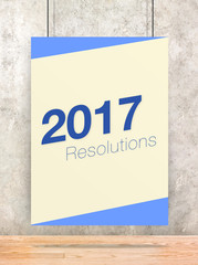 2017 Resolutions on cream and blue pastel color poster hanging o