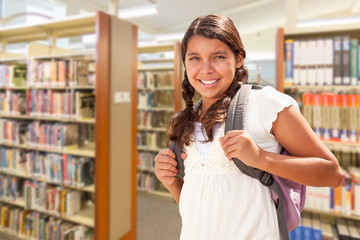 Hispanic Girl Student Walking in Library