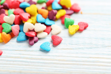 Colorful candy hearts on a blue wooden table
