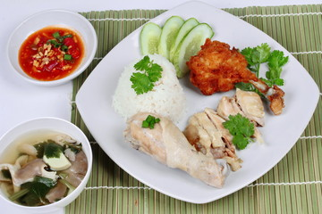 """Streamed oily rice and streamed chicken as """"Hainanese chicken rice"""" and deep fried chicken served with spicy soy bean sauce and mushroom soup."""