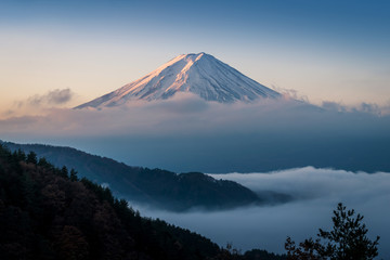 Mount Fuji enshrouded in clouds with clear sky from lake kawaguchi, Yamanashi, Japan