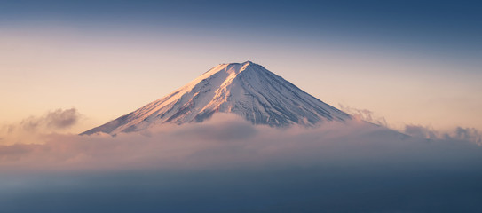Poster Japan Mount Fuji enshrouded in clouds with clear sky from lake kawaguchi, Yamanashi, Japan