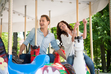 Couple having fun on a carousel