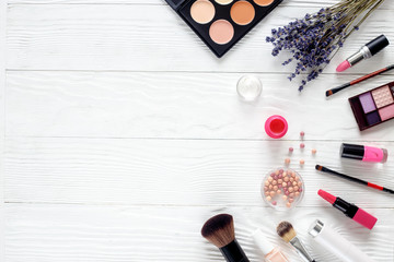 makeup set on wooden table with lavender top view