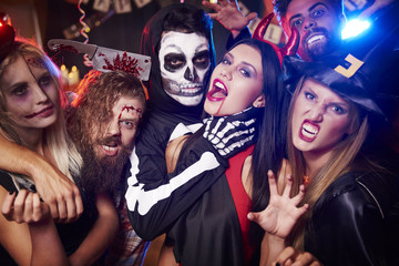 Spooky costumes of party people.