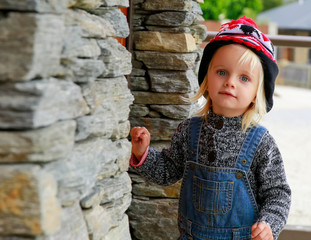 Phote of a Cute little girl knocking at the door. New Zealand