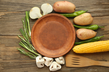 Empty plate with vegetables on table