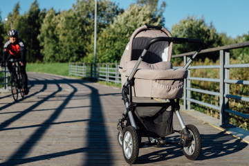 Baby stroller on running path in park
