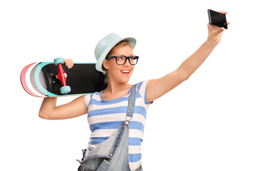 Female hipster taking a selfie