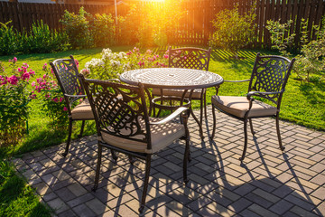 Table and chairs in garden of country house