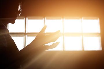 Leinwandbilder - Respect and pray in the room with sunrise through window background