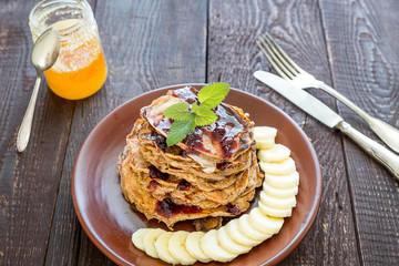 Stack of Healthy Low Carbs Apple Pancakes on the Dark Wooden Background