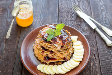 Stack of Healthy Vegan Low Carbs Apple Pancakes on the Dark Wooden Background