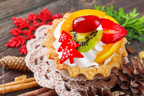 """Winter holiday rustic background with fruit tart and ..."