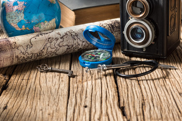 Still life photography : compass, camera, map , globe and key with space of old wood in traveler concept