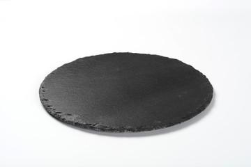 Plato de pizarra de color negro redondo