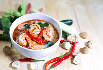 Tom yum kung, and condiment, on wooden table,Blur, Select focus