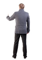 Back view of  business man shows thumbs up.   Rear view people collection. cheerful office worker shows positive emotions.  backside view of person.  Isolated over white background. stylish guy in the