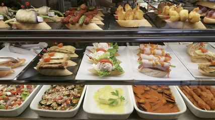 Tapas in the restaurant, Spanish typical food in Benidorm, Alicante, Spain.