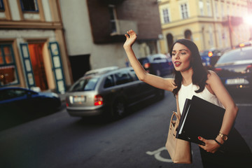 Businesswoman catching a taxi