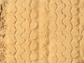 tracks tread wheel car on the sand