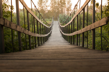 Fototapeten Bridges Suspended wooden bridge