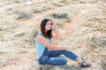 Fotobehang Beautiful teen girl in field with straw