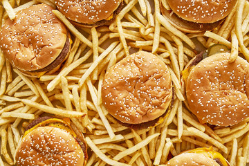 pile of burgers and fries in flat lay composition
