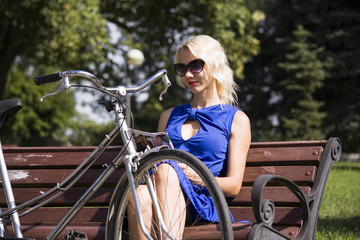 girl and an old bicycle